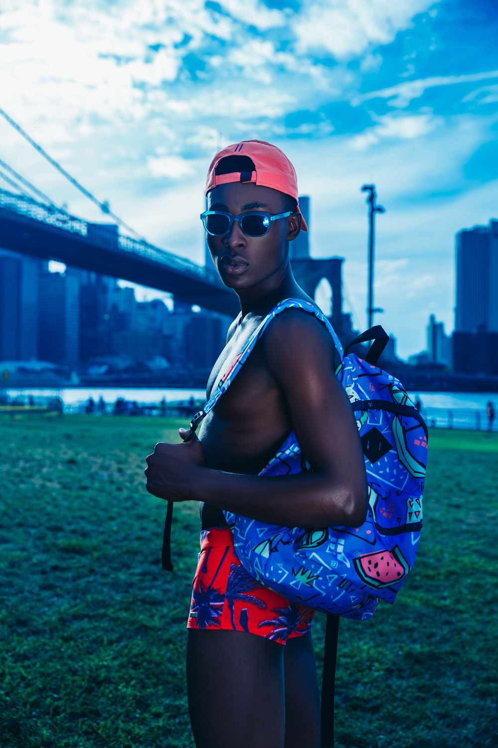 """Menswear blogger & stylist Jorge Gallegos teamed up with photographer Ignis Terram, to capture male model Jide True Alao in the story """"Indigo Summer"""". The whimsical and bright editorial celebrates the end of summer."""