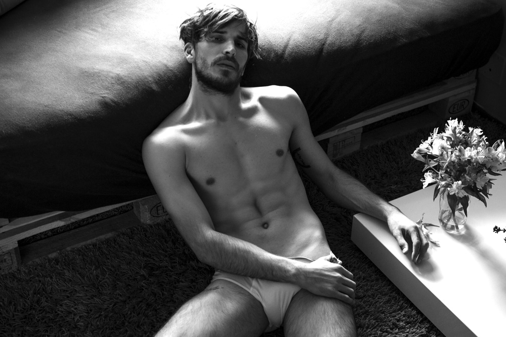 Meet Up and comer male model Arnaud Cornevin based in Brazil, signed at Joy Models posing in a black and white dashing session by Kenji Nakamura.