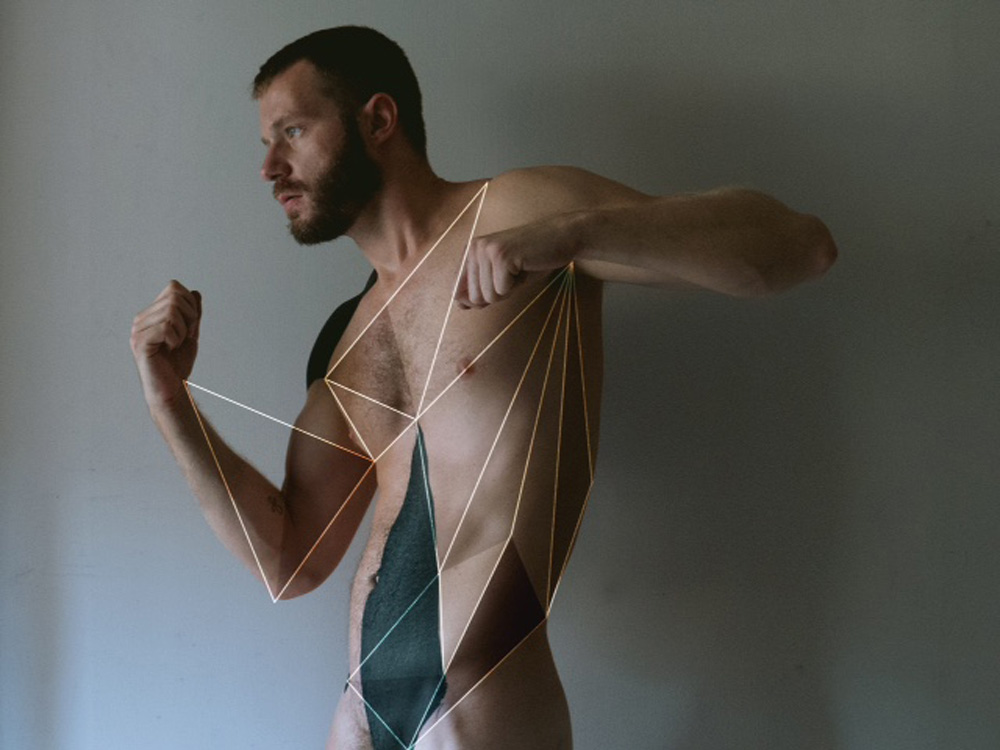 "Erik Lazarini a whispered mind and photographer in NYC who showing off an artsy photography entitled ""Lines and Shadows"" a beautiful set and natural lighting and featuring Mitch Mathias all eyes on shapes, lines and muscles."